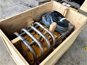 Heavy equipment in wood crate for transport