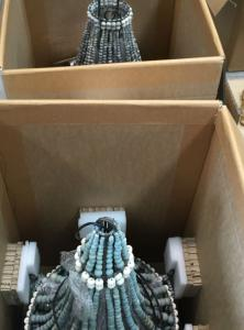 Chandeliers packed into a carton for transport
